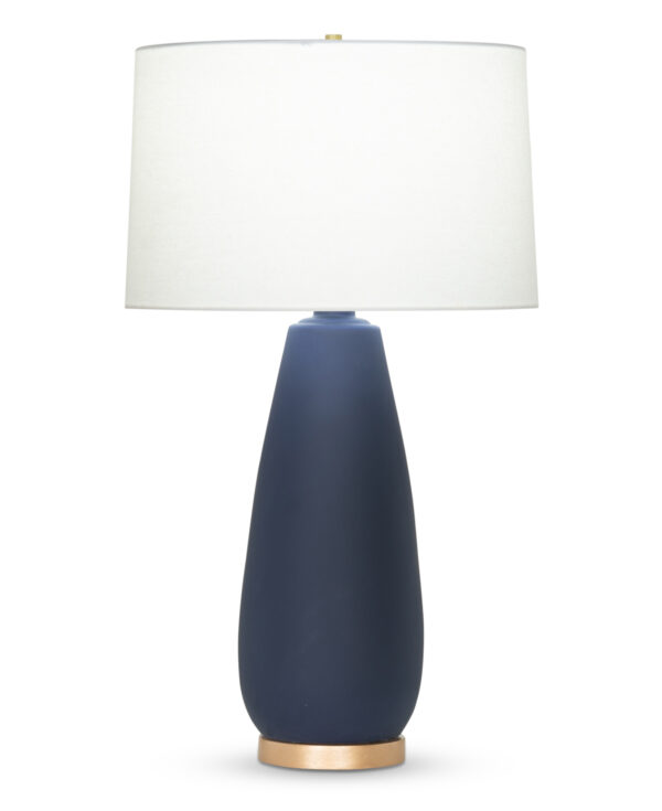 FlowDecor Duncan Table Lamp in ceramic with navy blue matte finish and resin base with gold finish and off-white linen tapered drum shade (# 4397)